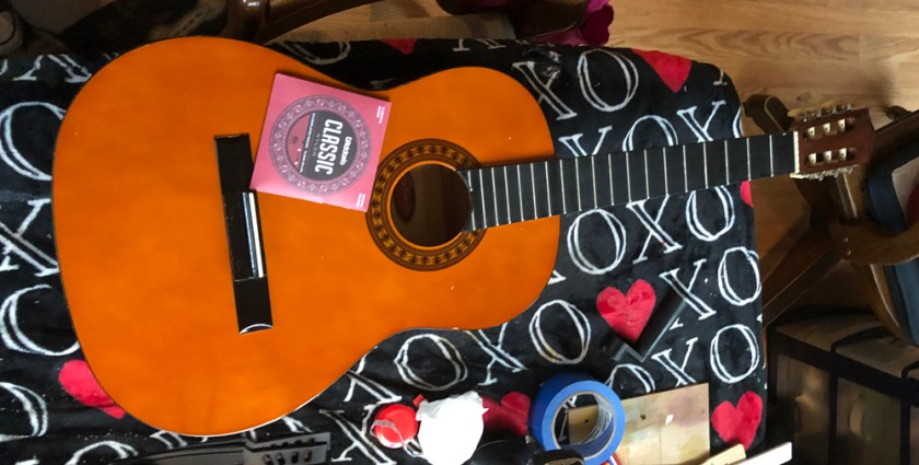 Restringing a Stagg classical guitar with D'Addario Classic nylon strings.
