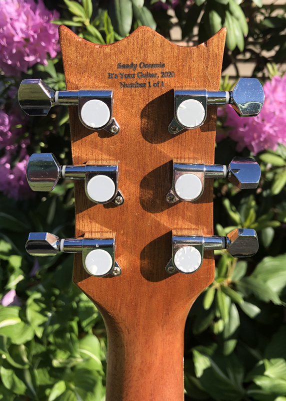 Sandy Oceania's laser engraved headstock.