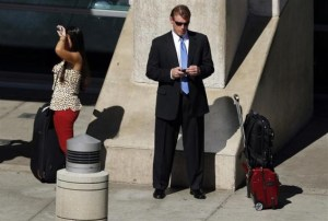 man-looking-at-his-mobile-reuters-635