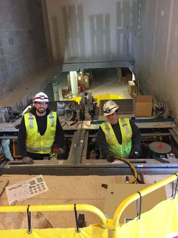 L91 Heather Lorancaitis and Dan Clark on an escalator Install at Corbins Corner.
