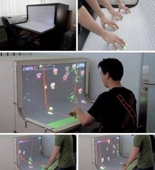 futuristic interactive multi touch1 318x350 Futuristic Desktop: 3D Multi Touch Computer + Desk Design