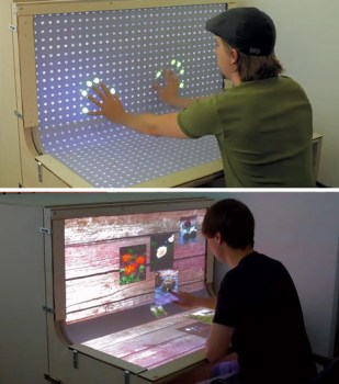 we 309x350 Futuristic Desktop: 3D Multi Touch Computer + Desk Design