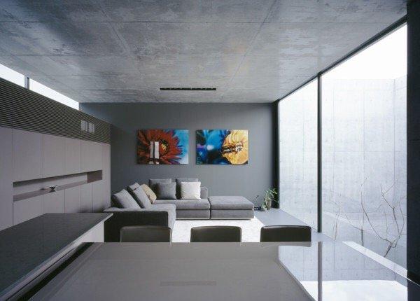 บ้านคอนกรีต สีเทาเรียบง่าย ที่ทำให้งานศิลปะโดดเด่น งดงาม 20 - ตกแต่งบ้าน