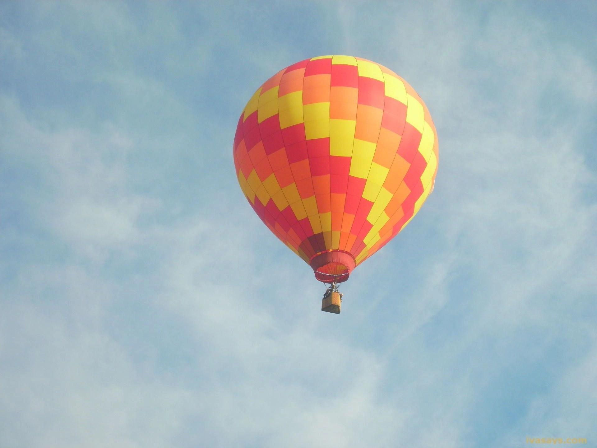 An Orange Hot Air Balloon Up in Air