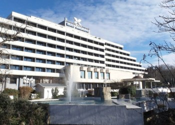 The entrance and front side of the hotel Interhotel Sandanski in Sandanski, Bulgaria
