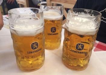 Three One-Liter Beer Mugs at Oktoberfest in Munich. Germany