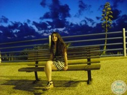 Sitting on a bench by the sea in Trappeto, Sicily | Visiting and Exploring the beautiful Sicilian island in Italy | #italy #travel #sicily - Iva Says