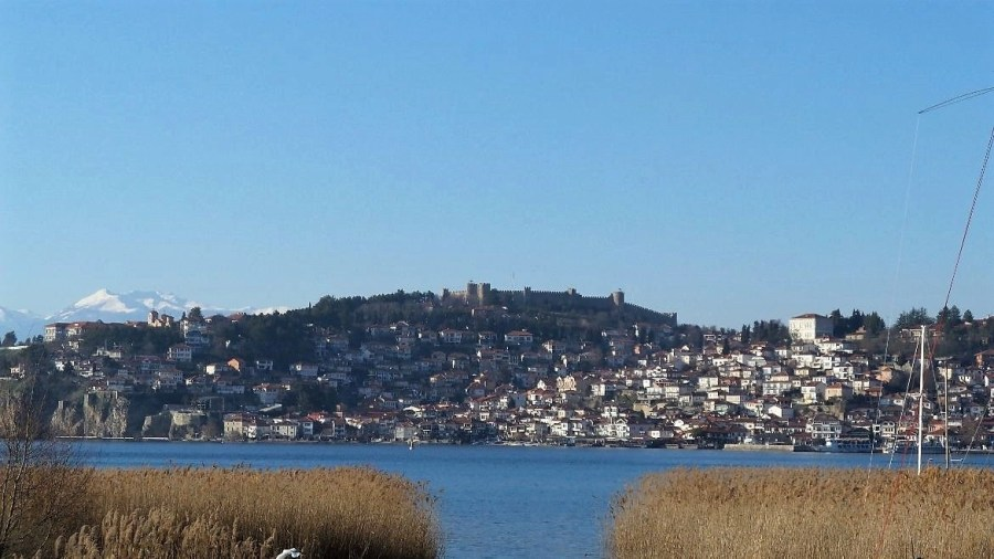 Fortress and city located on shoreline of a body of water.