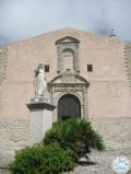 Statue of Beato Alberto (Blessed Albert) and the church of San Giuliano