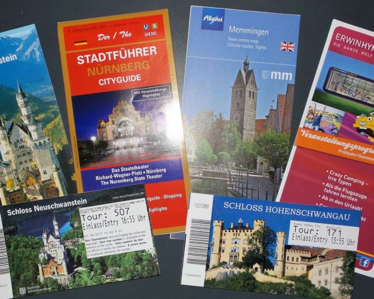 Collections of maps of Germany (Nuremberg, Memmingen, Castles) and pamphlets to represent travel souvenirs and memorabilia from trips taken.