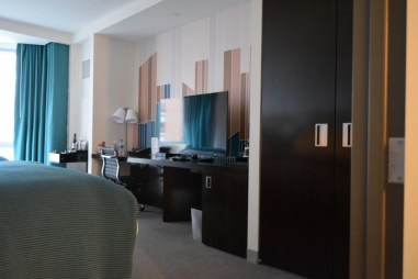The mini bar and the TV in W Hoboken Spectacular room.
