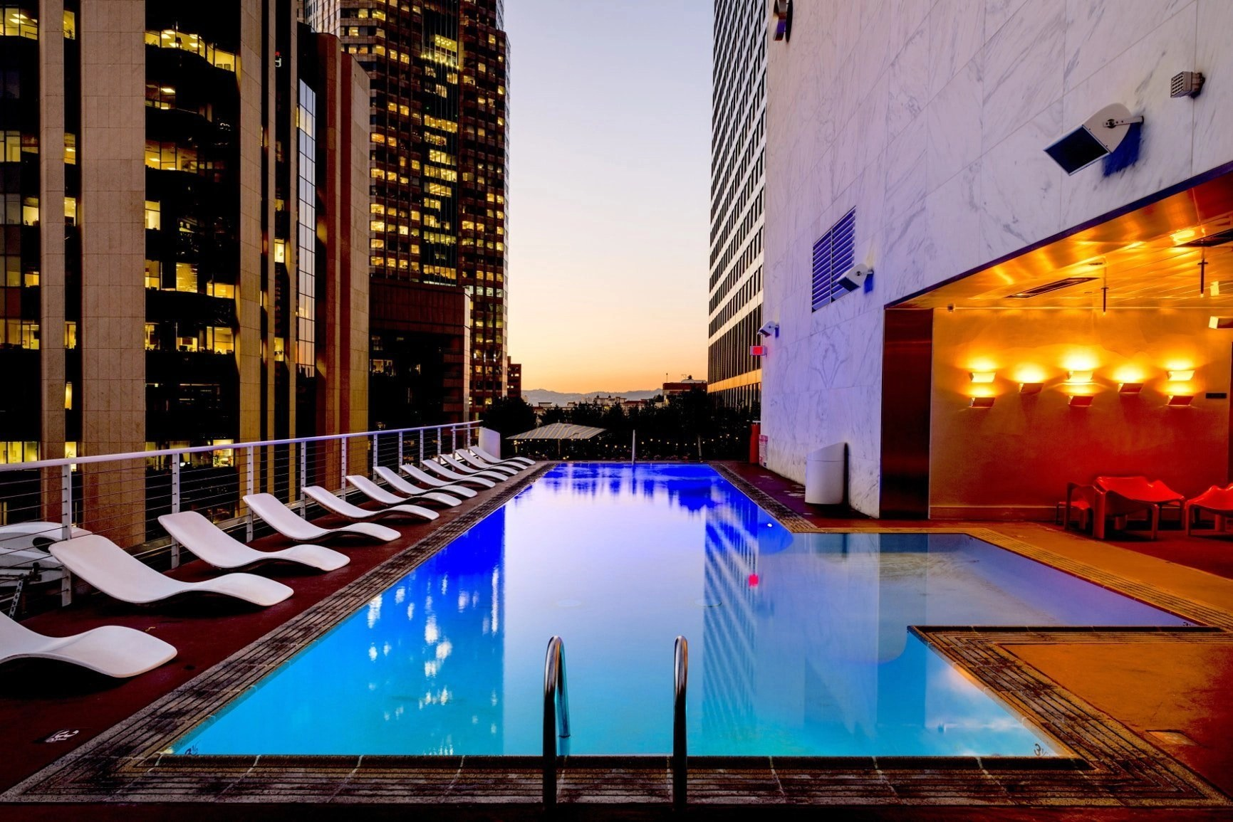 A hotel with modern architecture and view of pool for when you go traveling on your next vacation. Learn how properly packing will help you for a better, more relaxed vacation.