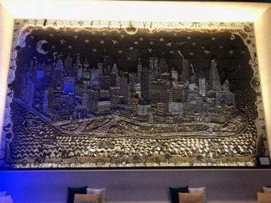A big metal mural in the hotel lobby of the W Hoboken representing the city Hoboken.