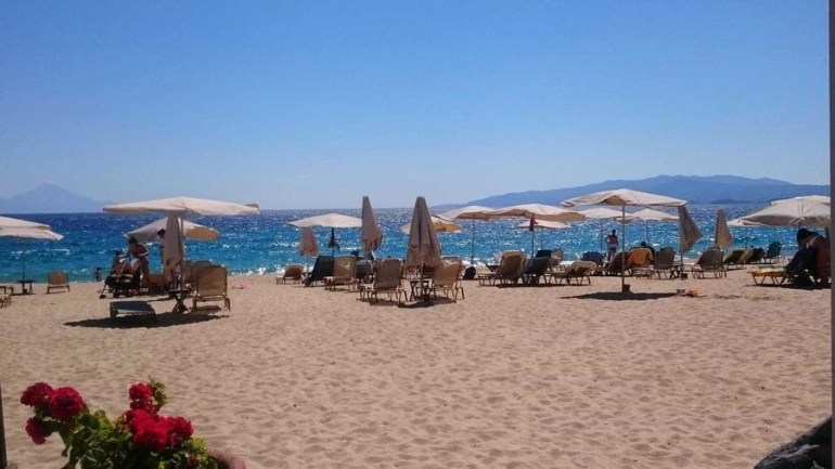 Assa Maris in Chalkidiki, Greece has the most beautiful sandy beach you will ever walk on. It's one the best beaches in Greece.