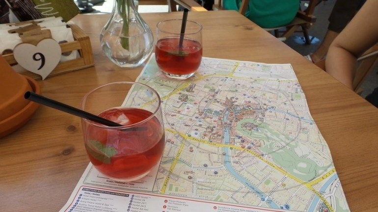 Two glasses of homemade Slovenian ice tea with a tourist map of Ljubljana.