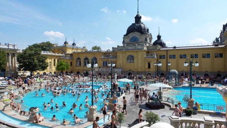 People swimming in the thermal baths at the Szechenyi Spa.