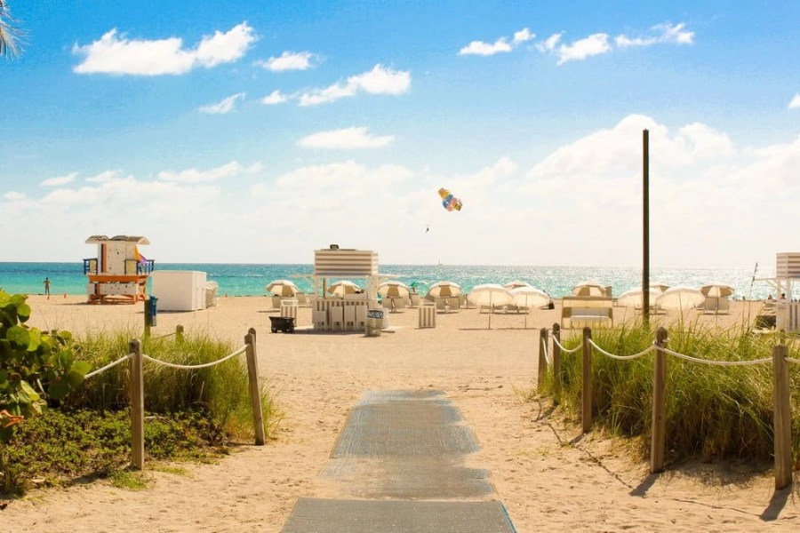 Wooden boardwalk leading to South Beach in Miami, Florida.