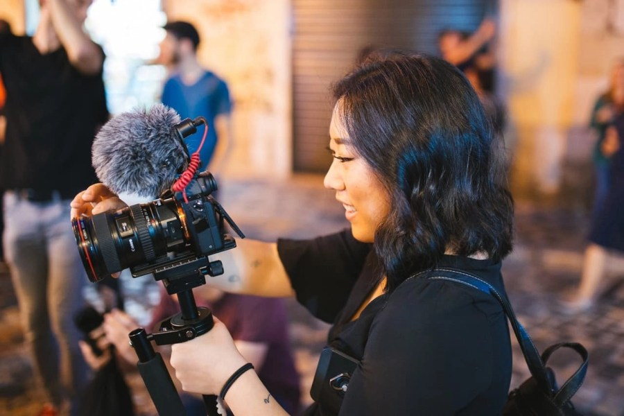 Woman holding a camera and recording.