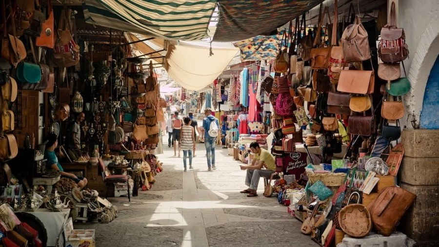 Purses and other accessories for sale in a traditional bazaar in Morocco.