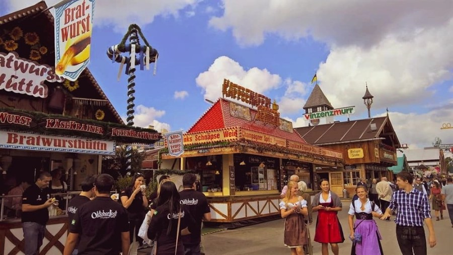 Happy People Walking Around Oktoberfest.