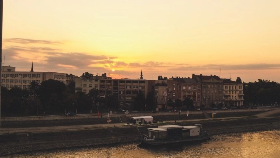 Sunset over the Dunabe River and buildings in Novi Sad.