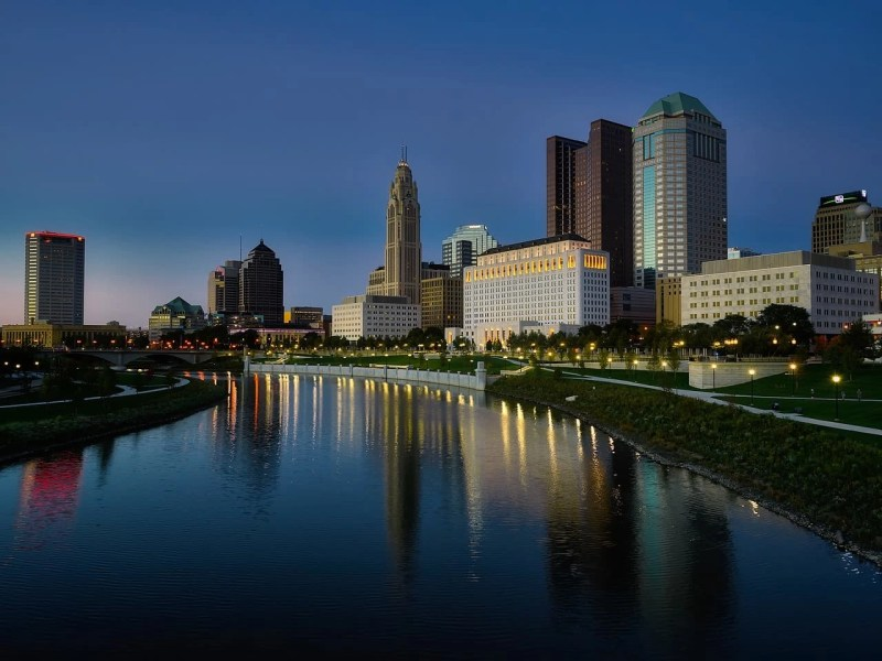 A river and skyscrapers at sunset time in Columbus, Ohio.