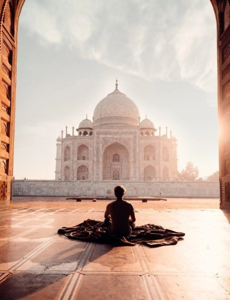 Person sitting in front of the Taj Mahal in India.