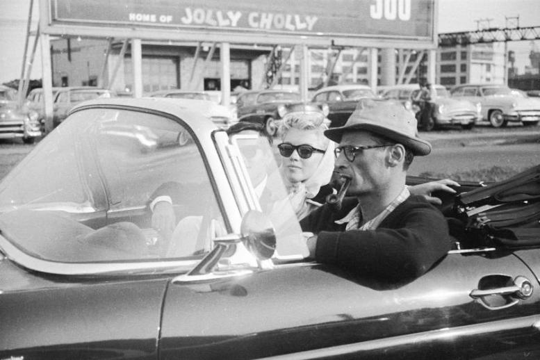 Subject: Actress marulyn Monroe riding in car with husband and playwright Arthur Miller. 1956 New York Photographer- Paul Schutzer Time Life Contributer (Not Owned) Merlin-1140408