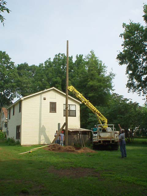 The plumb line was used to help get the pole straight.