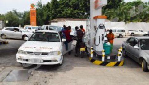 Gas pump attendant asks BIF 2400 per liter of gasoline