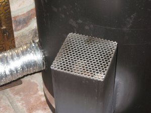 Rocket stove spark shield