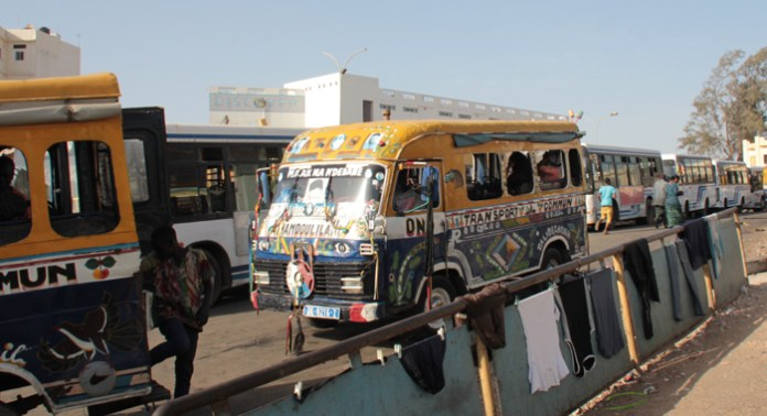 It's not uncommon to see these brightly painted buses in Dakar. One Senegalese said some of them could be as many as 25 years old. The navigate the city's traffic alongside some of the most modern and luxurious vehicles. (IWN photo)