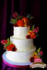(1112) Cornelli Lace Arch Wedding Cake with Autumn Flowers