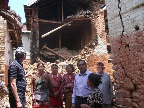 13.-JAAN-members-with-victims-in-their-damaged-house