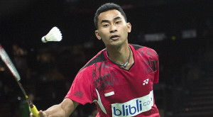 Sugiarto of Indonesia plays against Hu of Hong Kong during their men's singles match at the Badminton World Championship in Copenhagen
