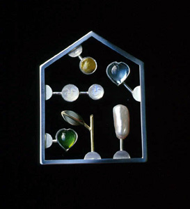 6.12 'Love Kit Green' 2002. Brooch; white metal, tourmaline, aquamarine, cultured pearl, moonstone, Iona marble, 18ct y gold