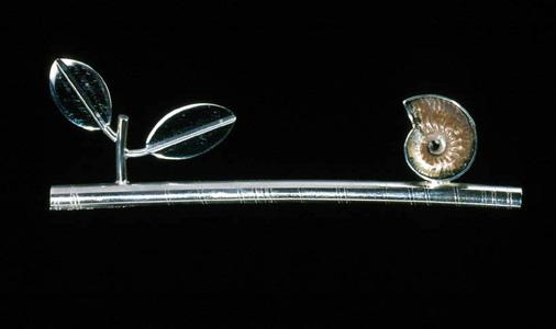 6.49 'Balance' 2000. Brooch; white metal, fossil