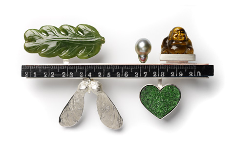 'Fragments' 2006. Brooch; white metal, tiger eye, green coral, nephrite, cultured pearl, wood