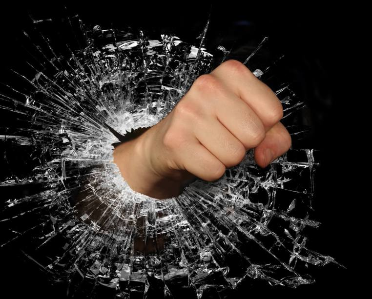 Image of a Fist Hitting Glass showing Feeling Angry