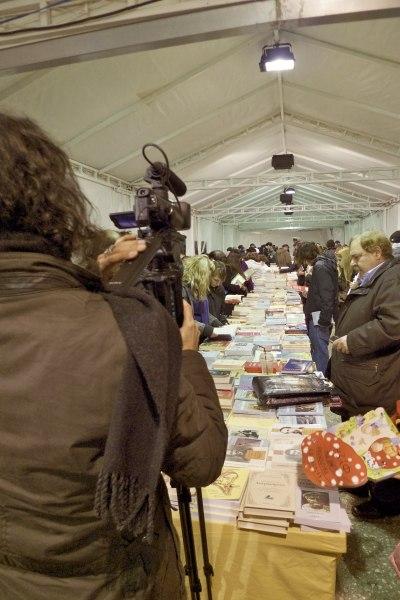 Cameraman inside the book bazaar