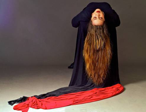 A woman lying with her hair flowing downwards