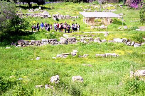 Tourists being guided in the archaeological site of the Athenian ancient agora.