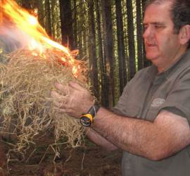 Mark blowing the ember to flame