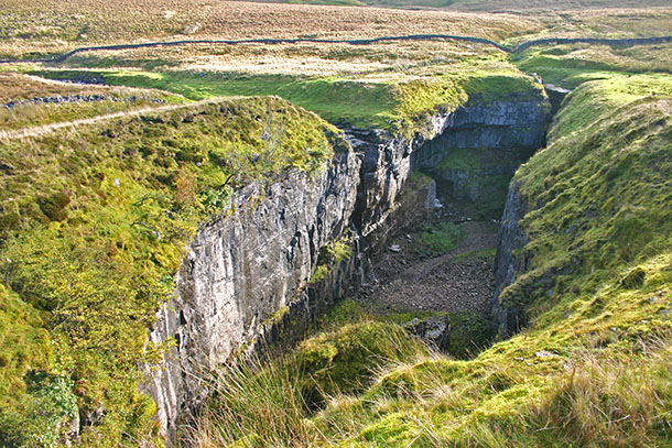 Hull Pot, beneath Penyghent in Ribblesdale