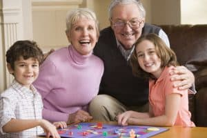 Grandparents and grandchildren playing a boardgame