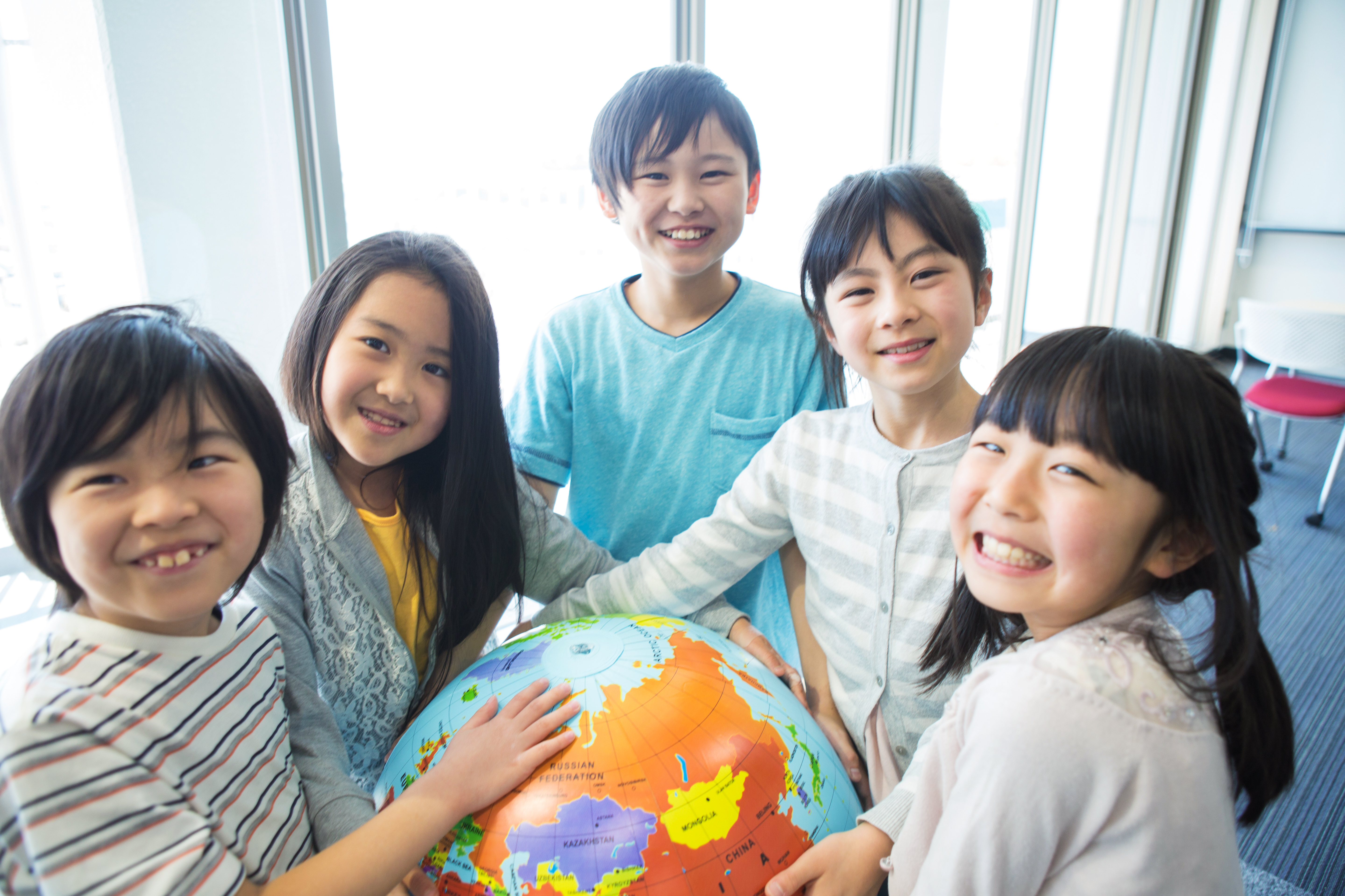 Japanese Children Holding Globe