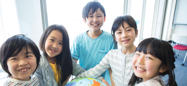 Japanese Children Holding Globe