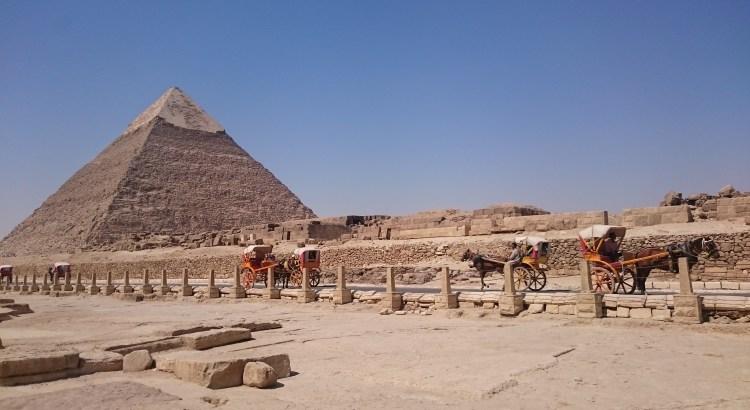 Pyramid at the Giza Necropolis with horse drawn carts.
