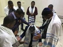 Ethiopia elders praying for director of Jacob's Hope Brent Johnson