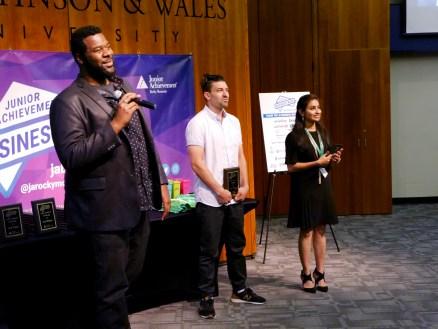 JA Venture Academy company advisors present awards at the JA Business Week closing ceremony